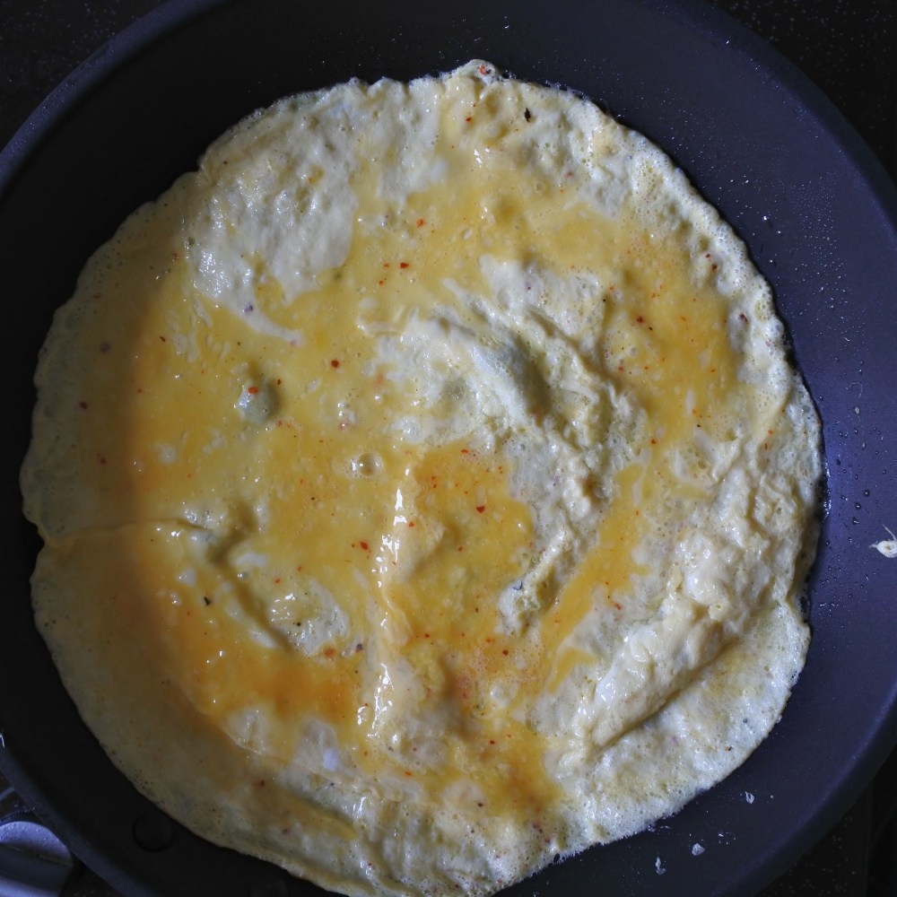 omelette cooking in pan