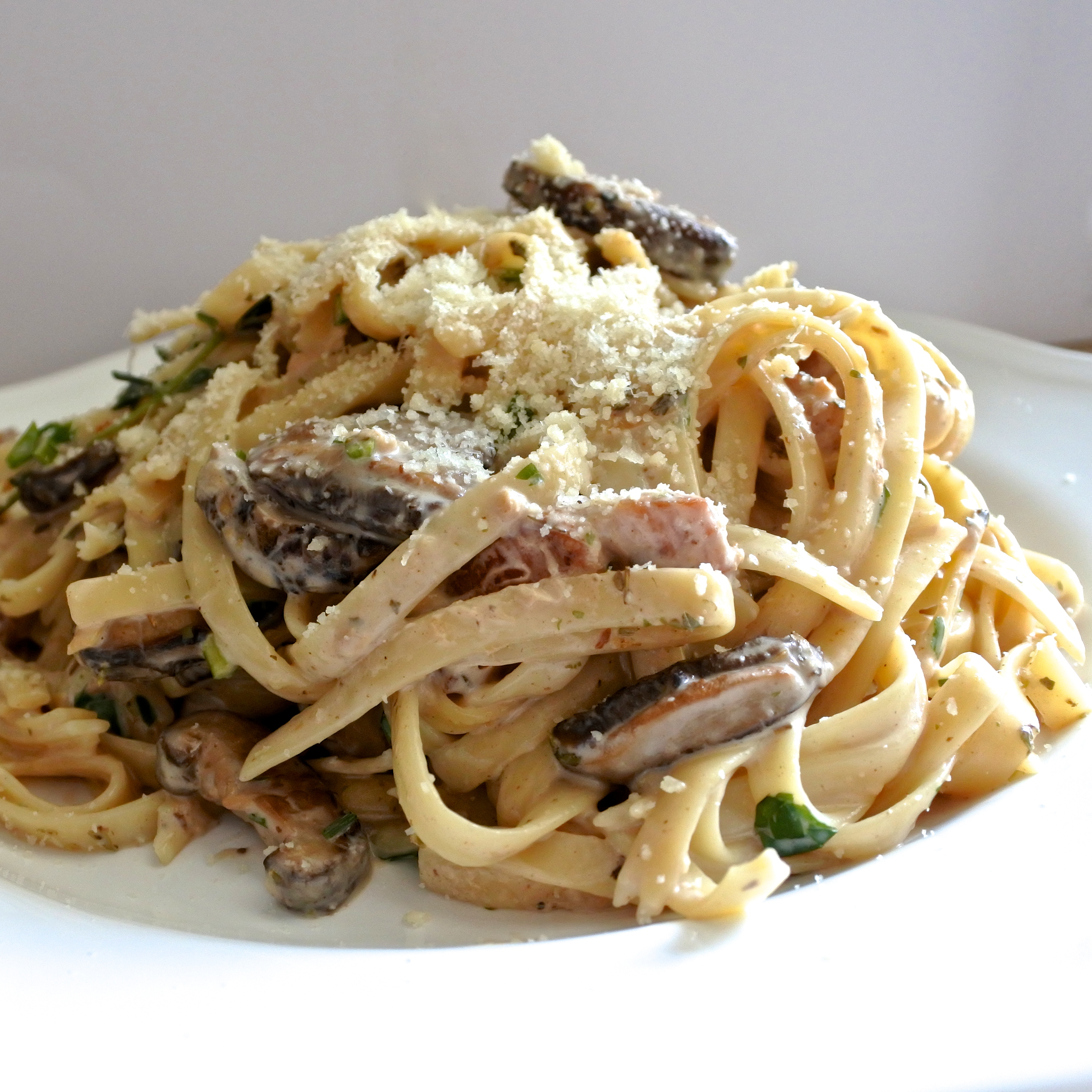 Fettuccine tossed in a Marsala cream sauce with smoked pork belly and mushrooms