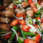 pork belly stir frying with chiles and onions