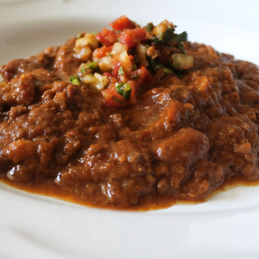 beef chili with beans topped with salsa