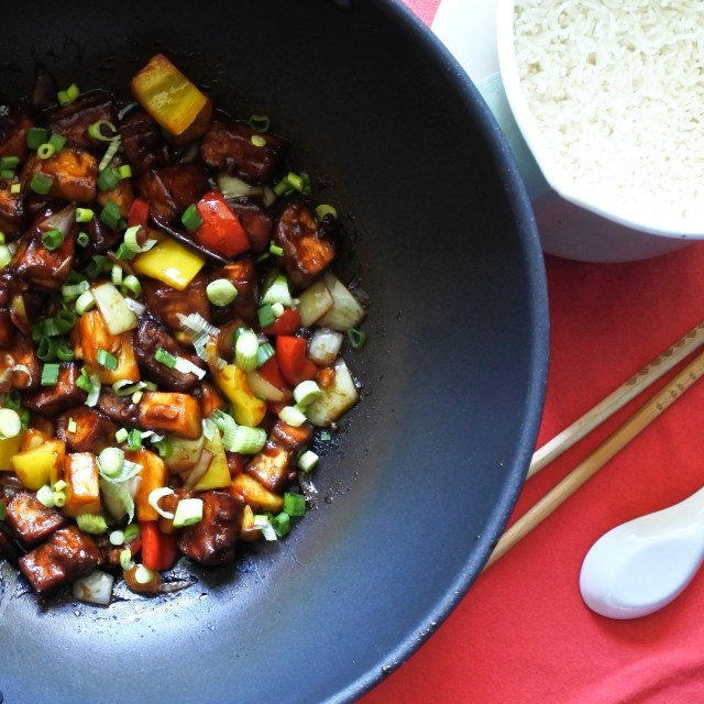 Sweet and Sour Tofu in wok with steamed rice