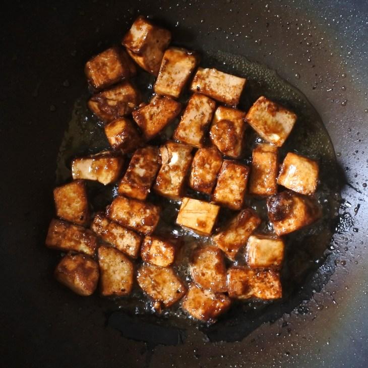 tofu frying in wok