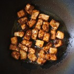tofu frying in wok