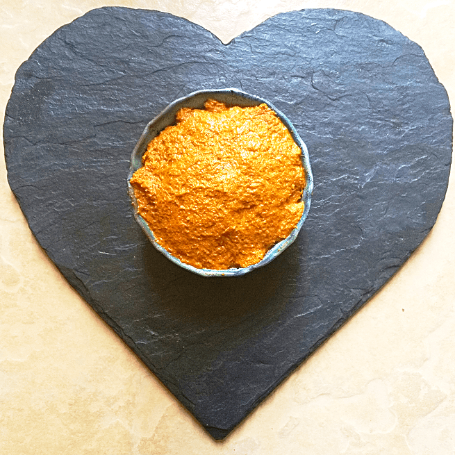Yellow Curry Paste in a bowl on heart shaped slate