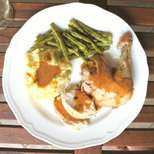 Roasted chicken leg, mashed potatoes, gravy and sauteed green beans