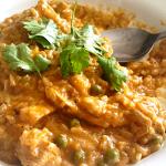 a spoon in a bowl of arroz con pollo