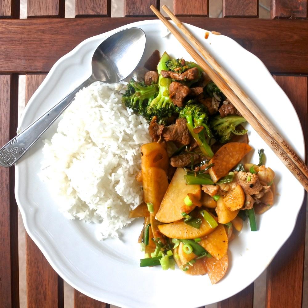 steamed rice, pork and broccoli stir fry, pork and pickled daikon stir fry