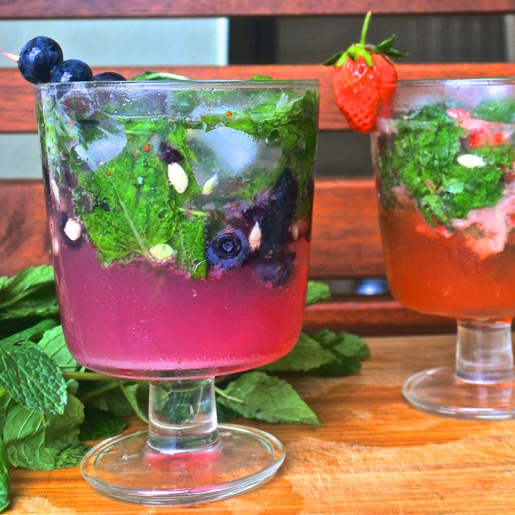 Blueberry and strawberry mojitos