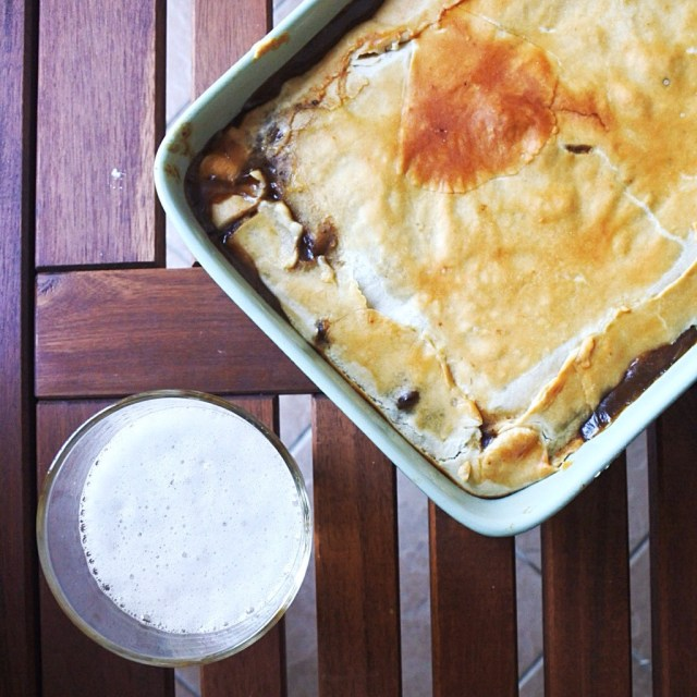 steak and ale pie in casserole dish with beer