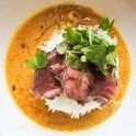 Basmati rice, seared beef and cilantro atop Mulligatawny soup
