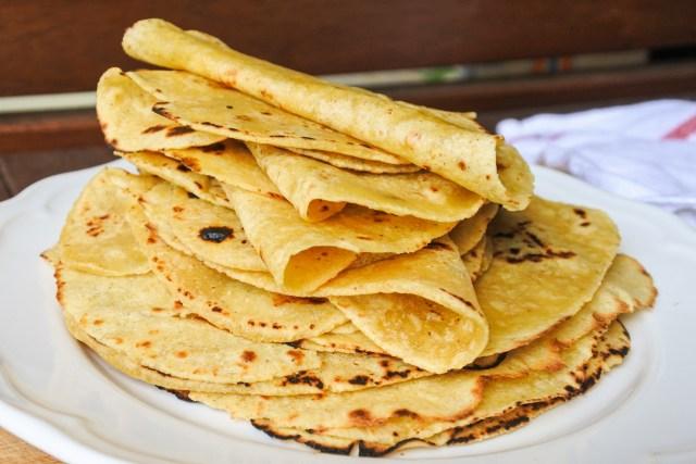 folded tortillas on a plate