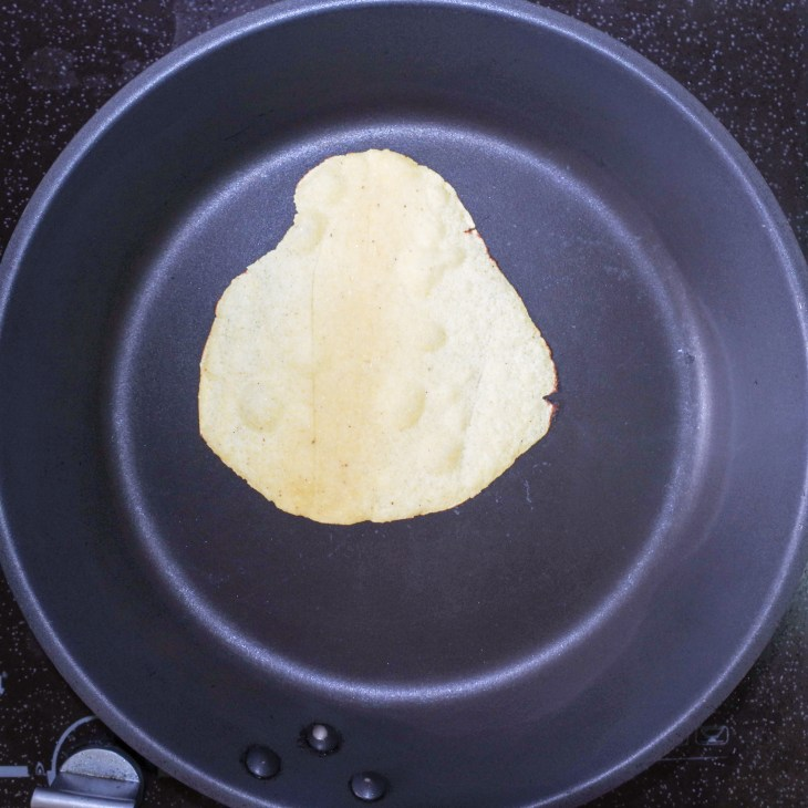 corn tortilla frying in pan