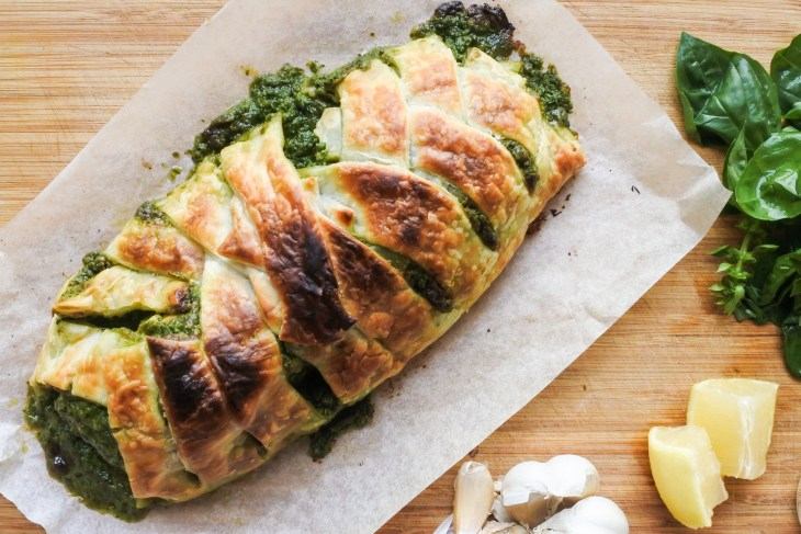 Salmon en croute, garlic, basil leaves and lemon