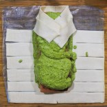 Starting from one end, take a side slit of pastry and fold downwards and across in a diagonal direction
