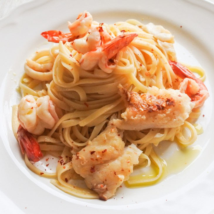 Fresh seafood tossed with linguine and garnished with chili flakes