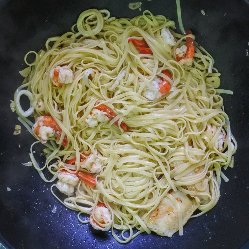 cooked linguine tossed with seafood