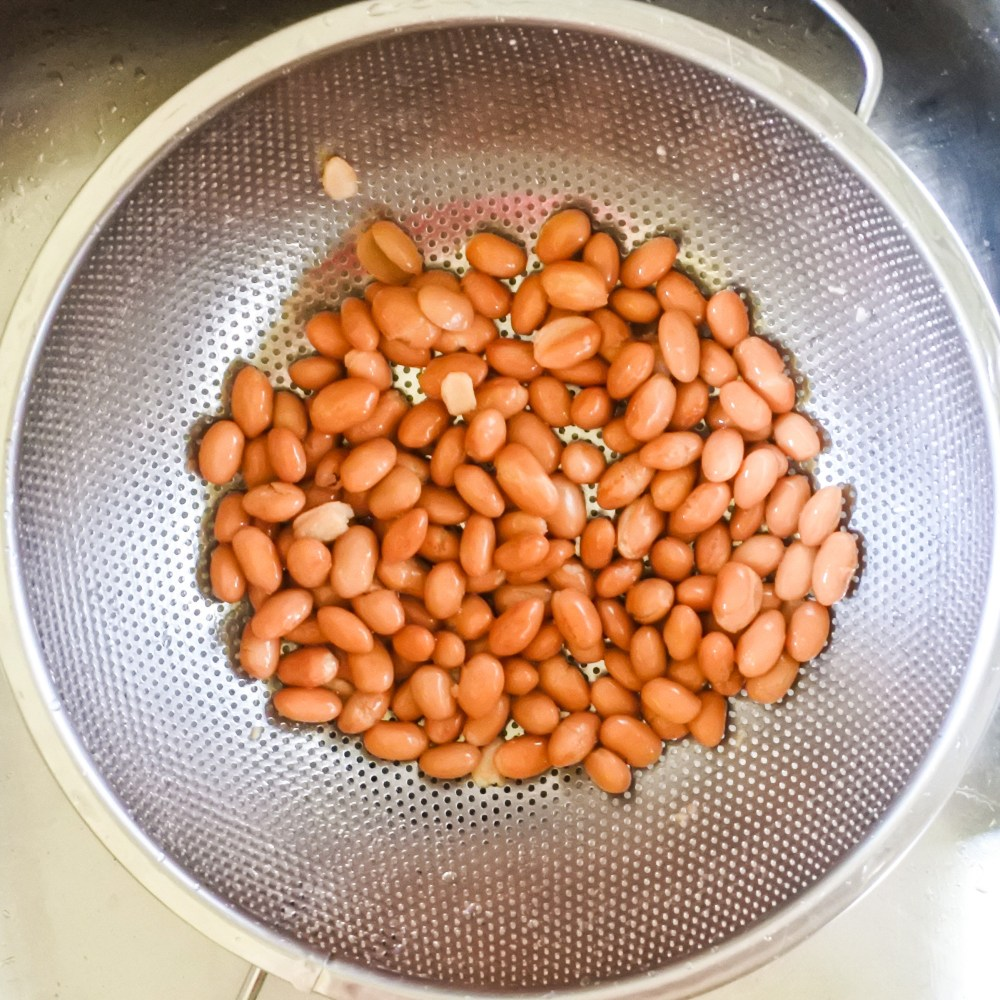 beans draining in metal colander