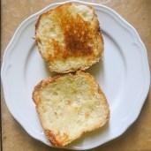 Toast a burger bun