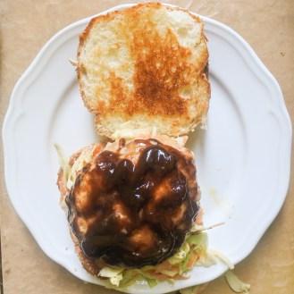 bbq armadillo patty on coleslaw and bun
