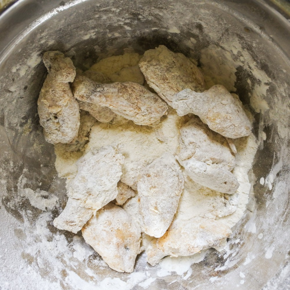 cooked wings dredged in flour mixture