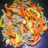 Add cooked beef. Stir-fry together for 1-2 minutes.