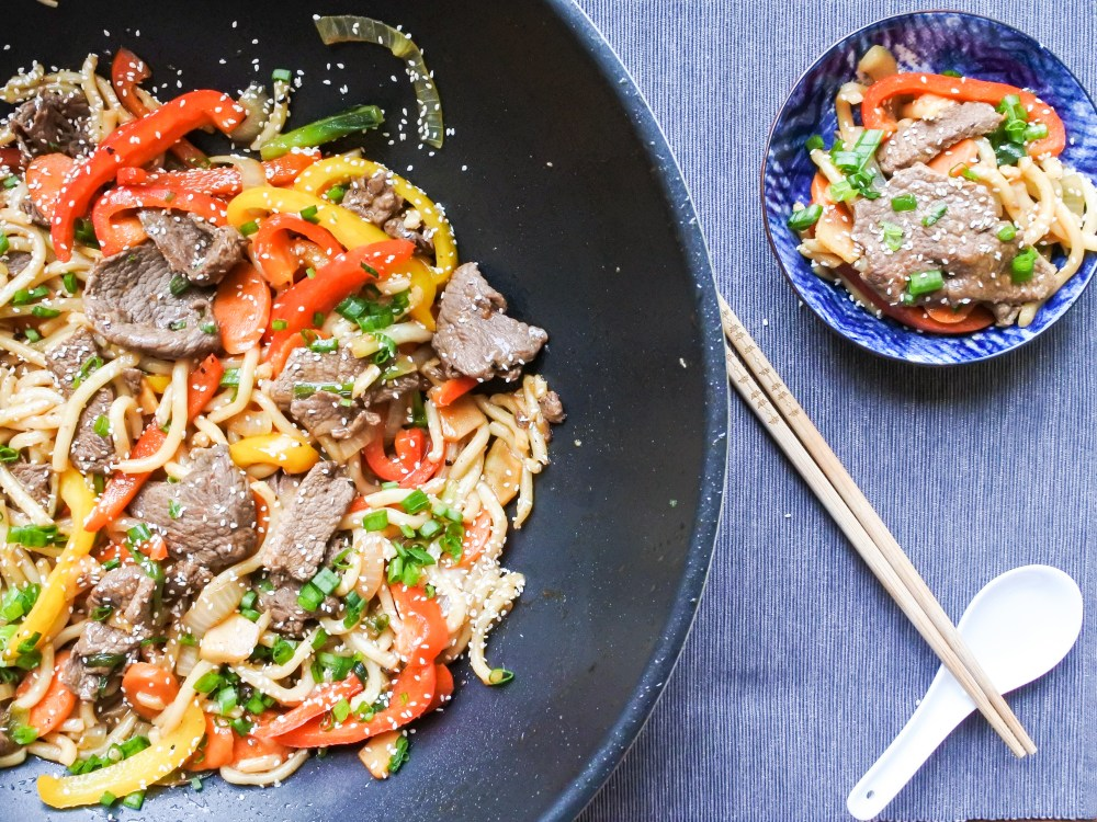 Wok Fried Beef Noodles in a wok and bowl