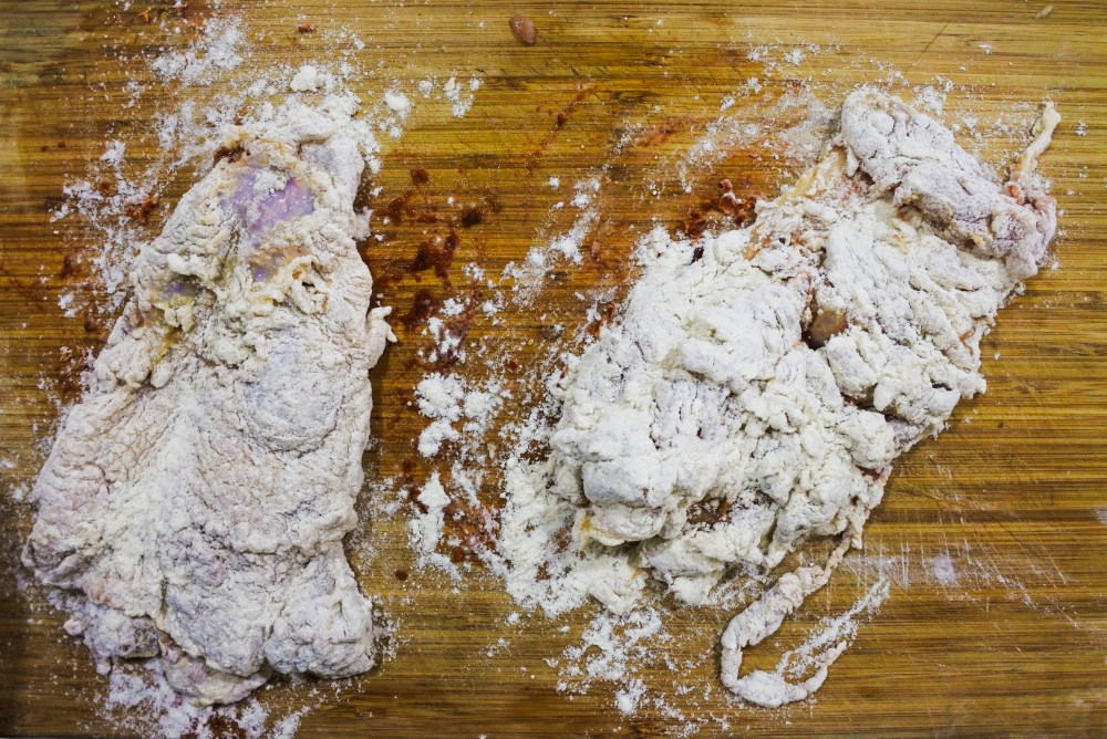 deboned chicken leg dredged in flour