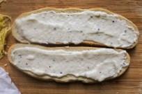 Spread 1-2 tbsp of béchamel sauce on each slice of bread.