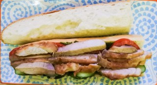 Place sliced pork strips atop of sliced cucumber and tomato
