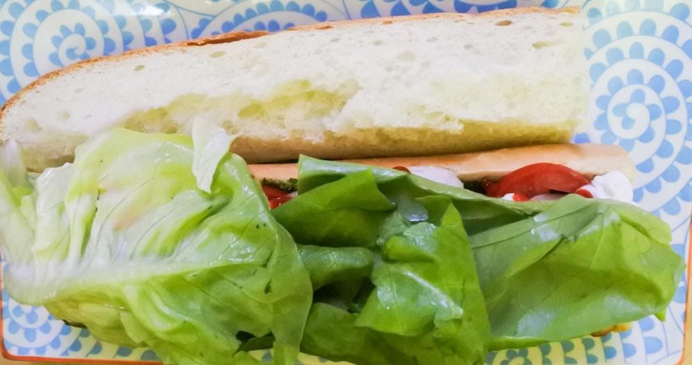 lettuce atop pork sandwich