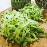 Grate a large cucumber