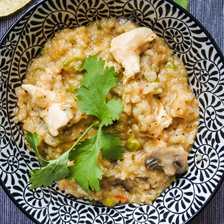 chicken, mushrooms and pea with rice garnished with cilantro