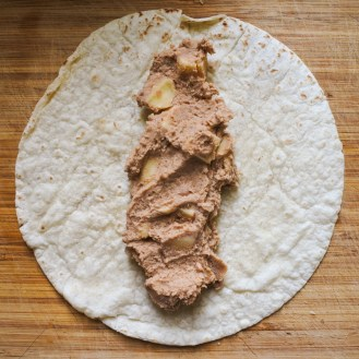 bean and cheese mixture on a tortilla