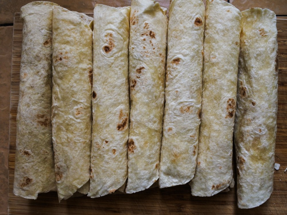 a line of bean and cheese burritos