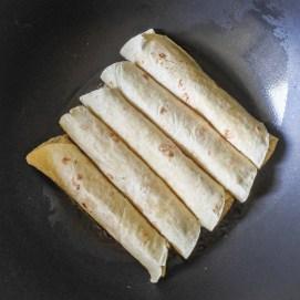 burritos frying in a pan