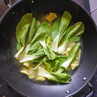 bak choy added to wonton mixture