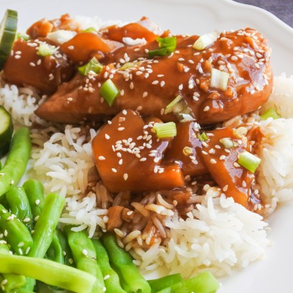 When sauce is thick, turn off heat and serve. Garnish with sesame seeds or chopped scallions and serve with steamed rice and sesame green beans.