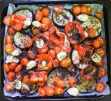 Place in the oven and roast for 45-60 minutes.  Check on the vegetables half way through and if you find the eggplant is dry, lightly brush with water and continue cooking in the oven. When vegetables have finished cooking and are nicely carmelized from roasting, remove from oven.