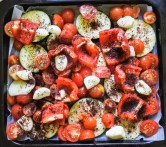 Put vegetables on baking tray and evenly spread about. Drizzle with olive oil. Sprinkle with sea salt, black pepper and za'atar.