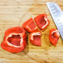 Wash and dry red bell pepper. Remove the seeds and cut into eight equal pieces.