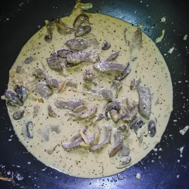 Beef stroganoff mixture cooking in a pan