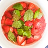 Combine sliced strawberries, water, sugar, lemon juice and mint in a medium saucepan. Bring to a boil over high heat and let cook for 5 minutes. Whisk to break down the strawberries, reduce heat to medium low and let simmer until you've reached the desired consistency. Sauce should be smooth and reduced slightly