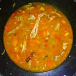 Turn heat to high, add chicken stock and crushed tomatoes.