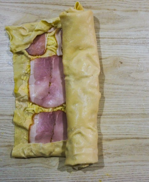 Pasta sheet being rolled up
