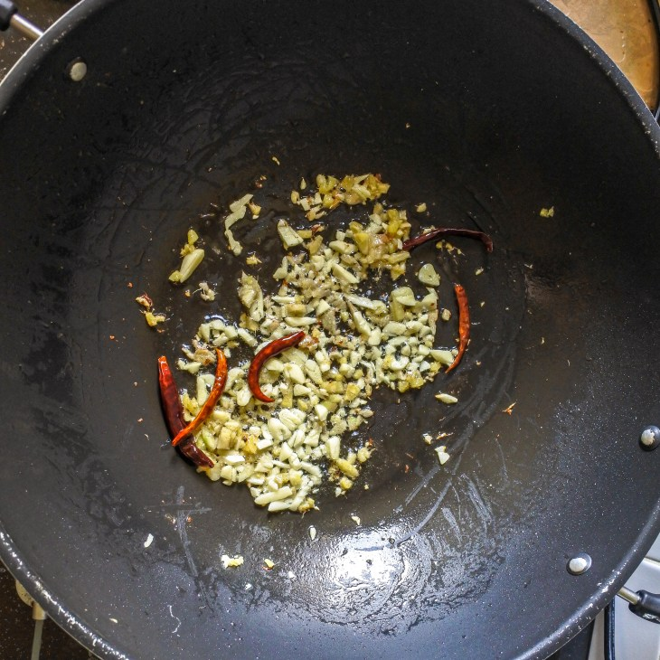 peppers, garlic and ginger frying in wok