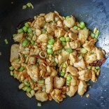 Kung Pao Chicken frying in sauce