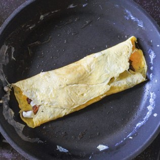 A folded French omelette in a pan