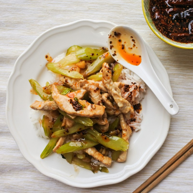 pork loin and celery stir-fry with steamed rice and Chinese chile oil