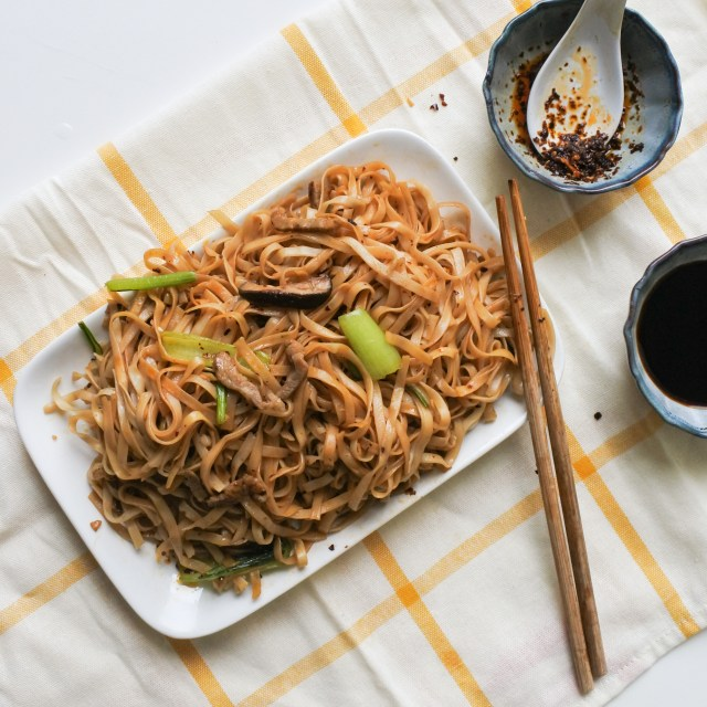 Shanghai noodles with pork and Choy sum tossed with Chinese Chile oil and black vinegar