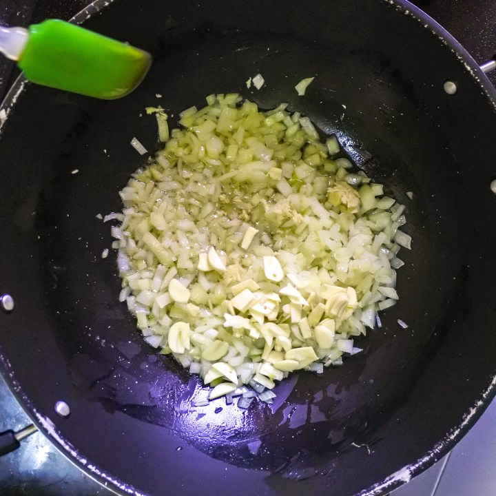 garlic and ginger added to frying onions in wok